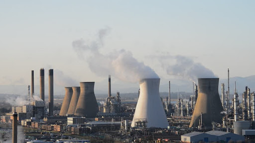 Oil refinery cooling towers smoking in Grangemouth Scotland