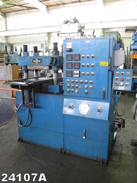 Heated platen laminating press